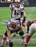New England Patriots quarterback, Tom Brady, points the way