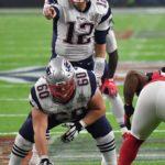 New England Patriots quarterback, Tom Brady, points the way