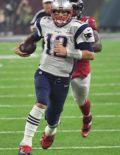 Patriots quarterback Tom Brady runs for a first down