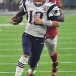 Patriots quarterback Tom Brady runs for a first down
