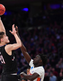 South Carolina forward Maik Kotsar scores on a hook shot