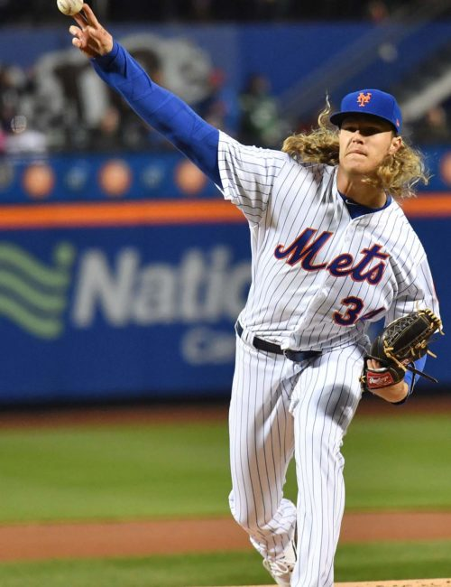 Mets starting pitcher Noah Syndergaard(Thor) throws the first pitch