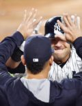 Yankees catcher Austin Romine high fives after hitting a home run