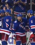 New York Rangers Derek Stephan celebrates with his teammates