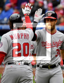 Washington Nationals Bryce Harper receives a high five from Daniel Murphy
