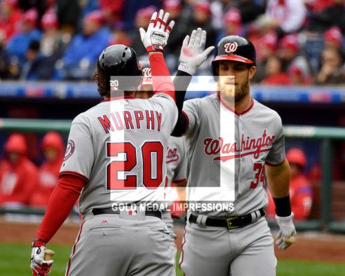 Washington Nationals Bryce Harper receives a high five from Daniel Murphy