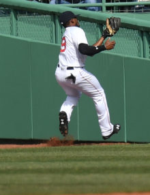 Boston Red Sox center fielder Jackie Bradley JR makes a circuit catch