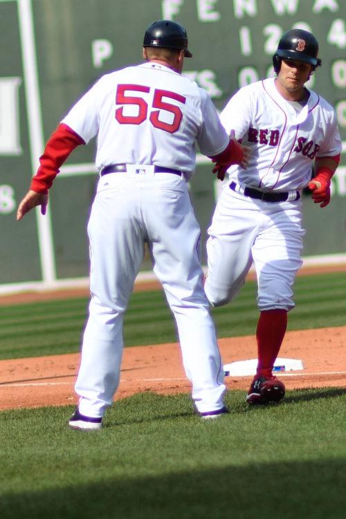 Boston Red Sox left fielder Andrew Benintendi congratulated