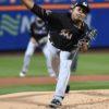 Miami Marlins starting pitcher Edinson Volquez throws a strike