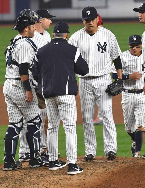New York Yankees manager Joe Girardi takes the ball from starter Masahiro Tanaka