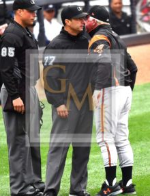 Baltimore Orioles red faced manager Buck Showalter nose to nose