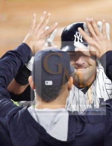 Yankees catcher Austin Romine high fives after hitting a home run