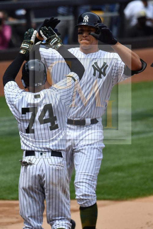 New York Yankees AARON JUDGE high fives RONALD TORREYES after hitting his first career grand slam home run off of Oakland Athletics starting pitcher Andrew Triggs, JUDGE'S 16th home run of the year and his 34th RBI. jUDGE went 2 for 4 leading the Yankees to a 9-5 victory.