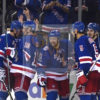 New York Rangers Derek Stephan celebrates with his teammates