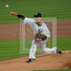 Yankees starting pitcher Masahiro Tanaka throws the first pitch of the game