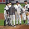 New York Yankees manager Joe Girardi takes the ball from starter Masahiro Tanaka