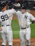 New York Yankees catcher GARY SANCHEZ celebrates his first of 2 home runs