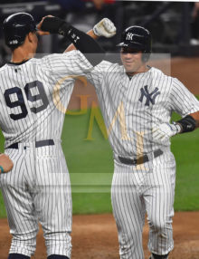 New York Yankees catcher GARY SANCHEZ celebrates his first of 2 home runs