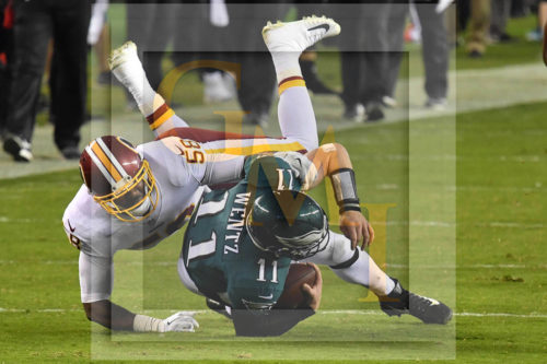 Eagles CARSON WENTZ is tackled by Washington Redskins linebacker JUNIOR GALLETTE