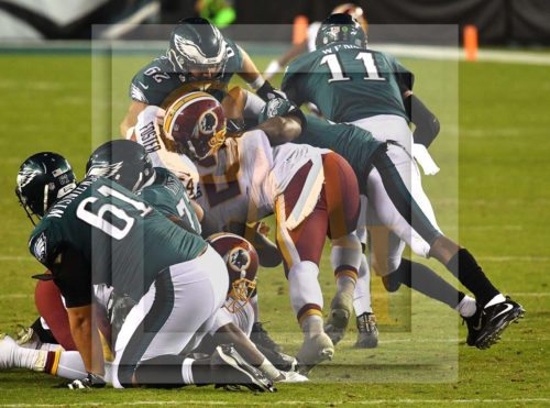 Eagles CARSON WENTZ pulls a HOUDINI trick by scrambling for 17 yards after being surrounded by Redskins