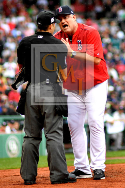 Red Sox manager JOHN FARRELL argues with home plate umpire