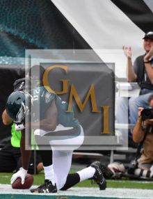 Eagles wide receiver TORREY SMITH prays after scoring