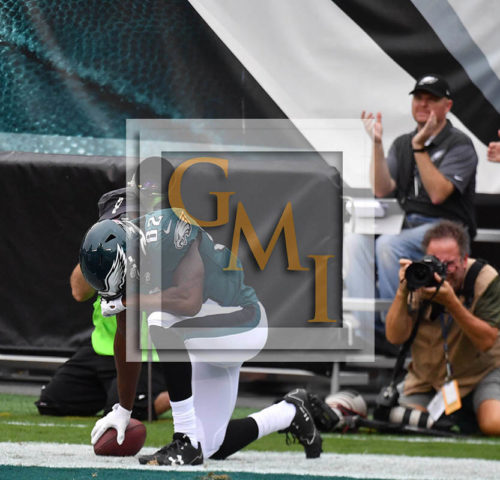 Eagles wide receiver TORREY SMITH prays after scoring