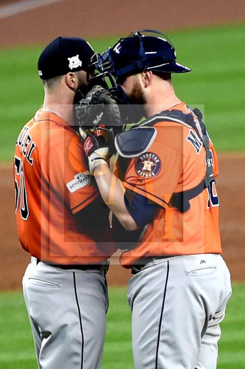 Astros DALLAS KEUCHEL and BRIAN McCANN have a tete a tete
