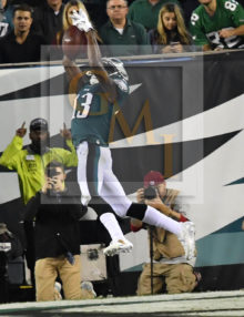 Eagles NELSON AGHOLOR makes a leaping catch, pic 1 of 3 in series