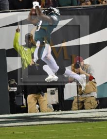 Eagles NELSON AGHOLOR makes a leaping catch, pic 2 of 3 in series