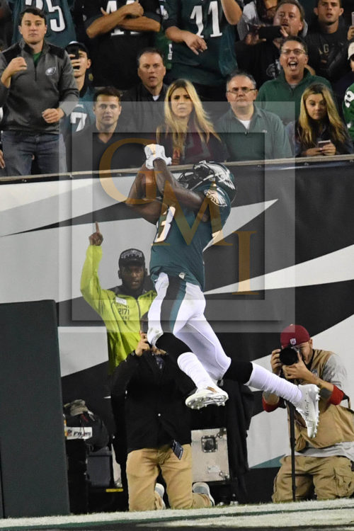 Eagles NELSON AGHOLOR makes a leaping catch, pic 3 of 3 in series