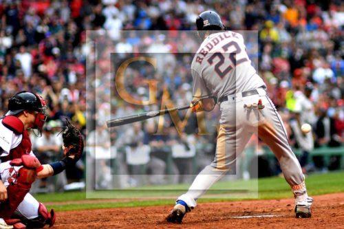 Astros right fielder JOSH REDDICK hits the game tie breaking single