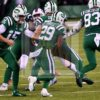 Jets quarterback JOSH MCCOWN hands off to BILAL POWELL