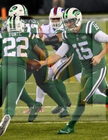 Jets quarterback JOSH MCCOWN hands off to MATT FORTE