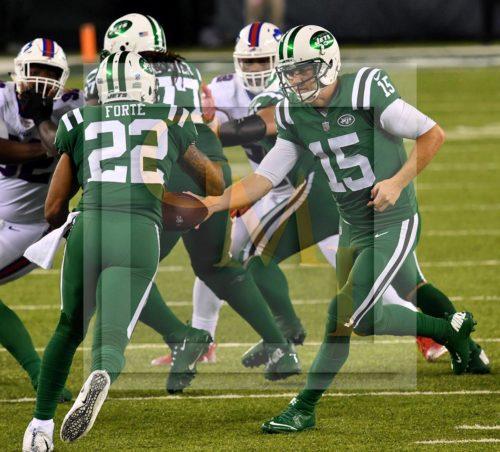 Jets quarterback JOSH MCCOWN hands off to MATT FORTE