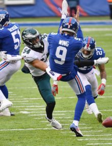 Eagles outside Linebacker KAMU GRUGIER-HILL blocks a BRAD WING punt