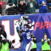 Eagles wide receiver NELSON AGHOLOR makes a leaping catch