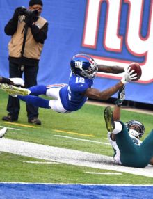 Giants wide receiver TAVARRES KING leaps into the end zone