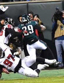 Philadelphia Eagles running back LE GARRETTE BLOUNT runs over Atlanta Falcons defensive tackle GRADY JARRETT