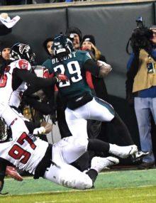 Philadelphia Eagles running back LE GARRETTE BLOUNT runs over Atlanta Falcons defensive tackle GRADY JARRETT