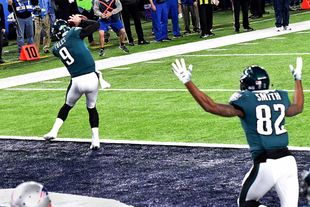 Eagles quarterback NICK FOLES receives a touchdown pass just before half time
