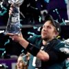 Eagles quarterback NICK FOLES raises the Lombardi Trophy