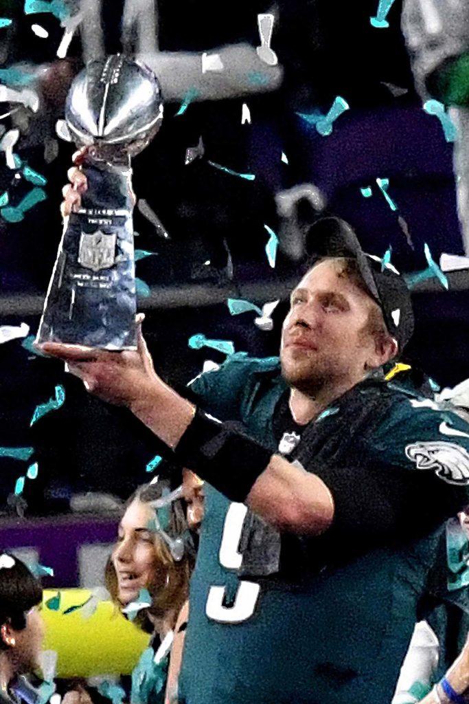 Eagles quarterback NICK FOLES raises the Lombardi Trophy