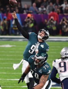 Eagles quarterback NICK FOLES passes downfield