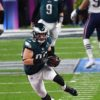Eagles tight end ZACH ERTZ drives for a first down
