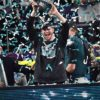 Eagles injured quarterback Carson Wentz holds up the Lombardi Trophy
