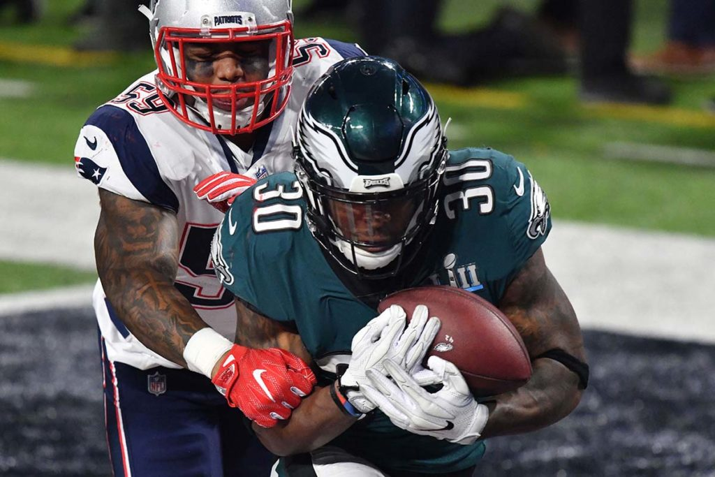 agles running back COREY CLEMENT scores a touchdown in the third quarter
