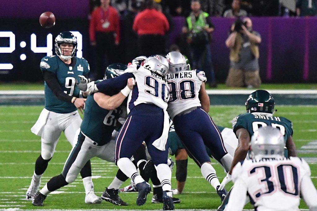 Eagles quarterback NICK FOLES completes a pass to TORREY SMITH