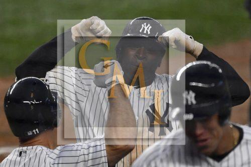 New York Yankees Didi Gregorius gets a high five from Brett Gardner