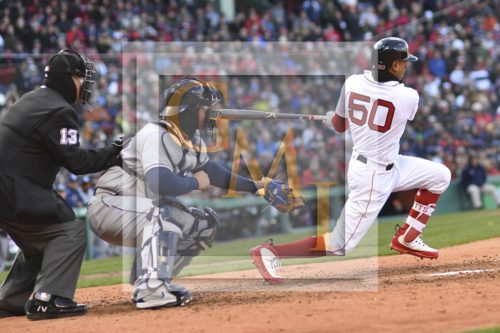 Red Sox lead-off hitter Mookie Betts hits a single to begin a Red Sox rally